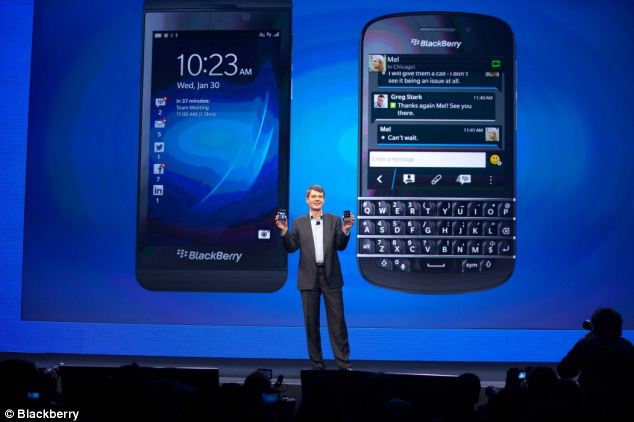 BlackBerry chief executive Thorsten Heins with the firm's two handset, the Z10 touchscreen, left, and the Q10 with a keyboard (right)