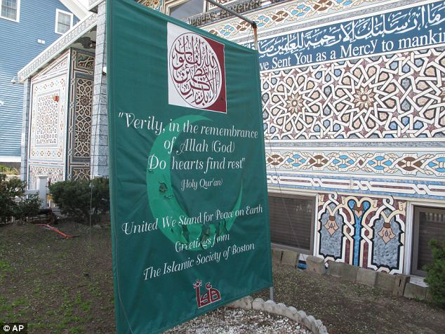 Place of worship: A banner reading 'United We Stand For Peace on Earth' stands outside the Islamic Society of Boston mosque in Cambridge, Massachusetts, where Tamerlan Tsarnaev attended