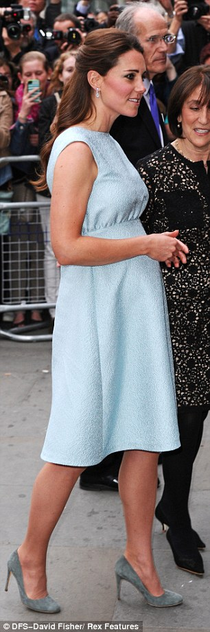 Maternity chic: Kate's bump was more visible as she stepped out at the National Portrait Gallery this evening