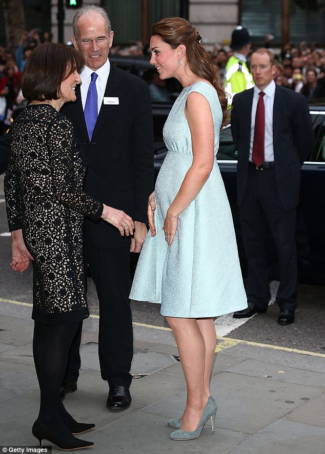 Six months along: The Duchess bump was more evident as she met staff at The Art Room