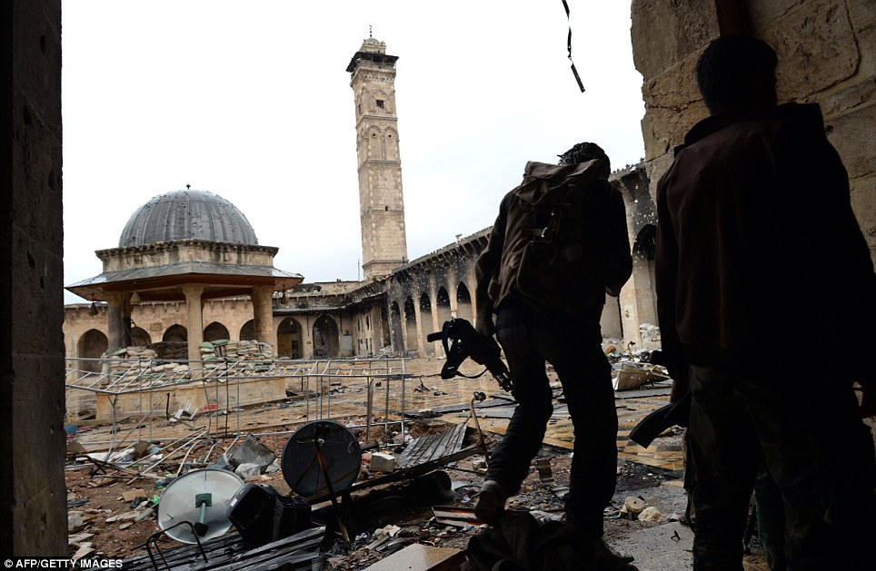 A picture from last week shows Syrian rebel fighters walking in the Umayyad Mosque complex