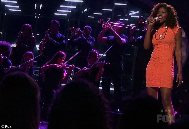 She's a peach: With her orange dress and her backing string section it was one of her most memorable turns