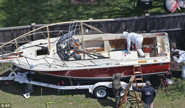Confused reports about the shootout in a Boston backyard have emerged. Officials now claim that Dzhokhar Tsarnaev was unarmed as he hid in boat in Watertown. This contradicts Boston Police Commissioner's account of hour-long firefight with Tsarnaev
