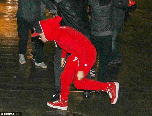 Keeping his head down: Justin threw a temper tantrum because the stylist at the shoot asked him to wear a bell boy hat