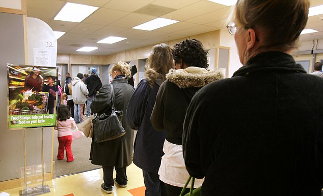People line up for their monthly debt cards and food stamps all over the country