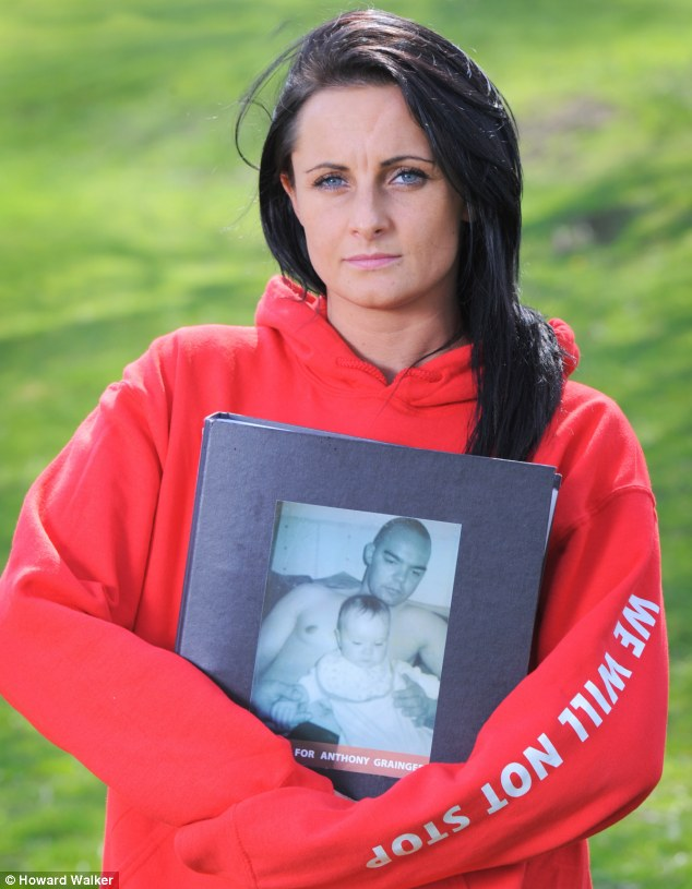 Seeking answers: Gail Hadfield, holding a picture of Anthony Grainger and one of his children, wants the police to reveal details of what happened on the night he was killed