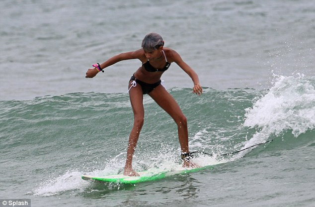 Surfing safari: Willow Smith took to the surfboard like a pro during a mother-daughter holiday in Hawaii