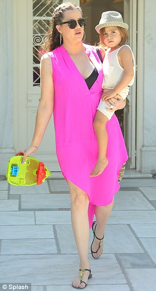 Hot in pink! Earlier that day she paraded her frame in a bright dress as she carried Kourtney's son Mason