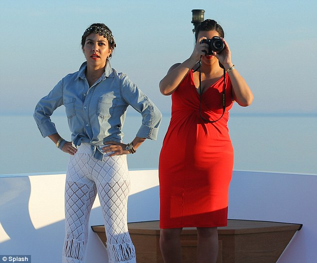 Say cheese: The reality star must have spotted a good view or another family member as she took a photo of something in the distance