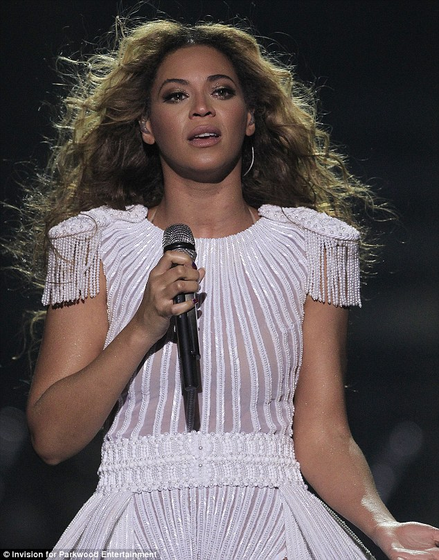 Beautiful in white: Beyoncé wowed fans with her show at the O2, with many tweeting that she simply brought the house down