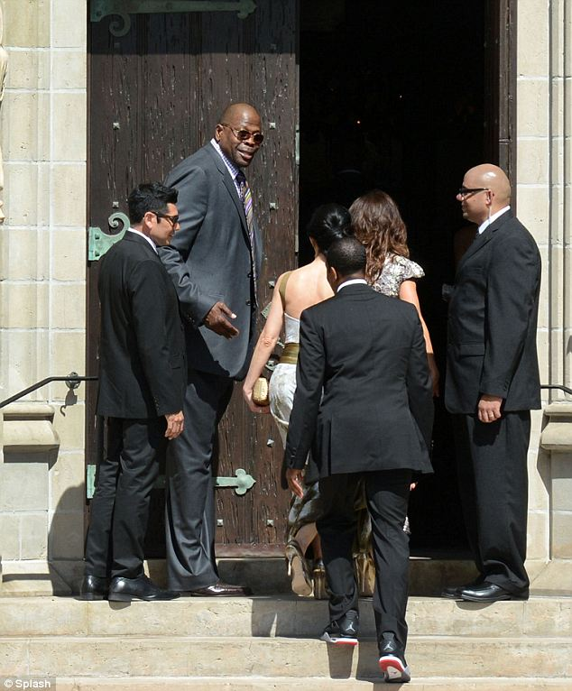Tall usher: Patrick Ewing, the 7-foot former all-star acted as usher outside the doors of the Bethesda-By-The-Sea Church in Palm Beach