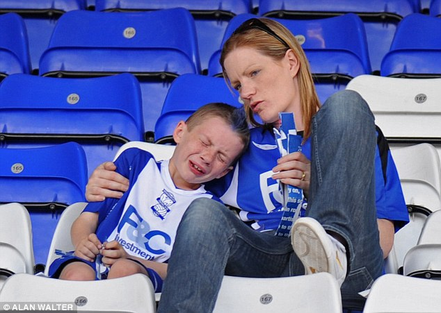 Feeling blue: A young Birmingham City fan sees his side relegated in 2008