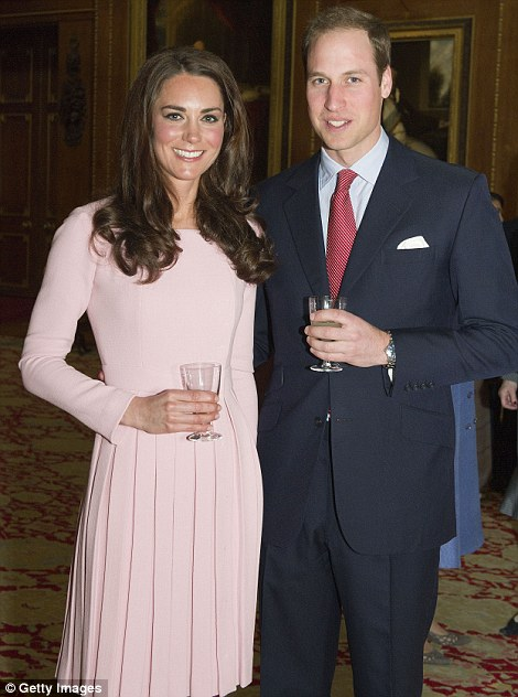 MAY 2012 Catherine, Duchess of Cambridge and Prince William, Duke of Cambridge during a reception in the Waterloo Chamber, before the Lunch For Sovereign Monarchs at Windsor Castle