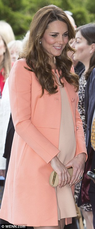 What Kate wore: The Duchess of Cambridge donned this £380 Tara Jarmon Cotton Twill coat