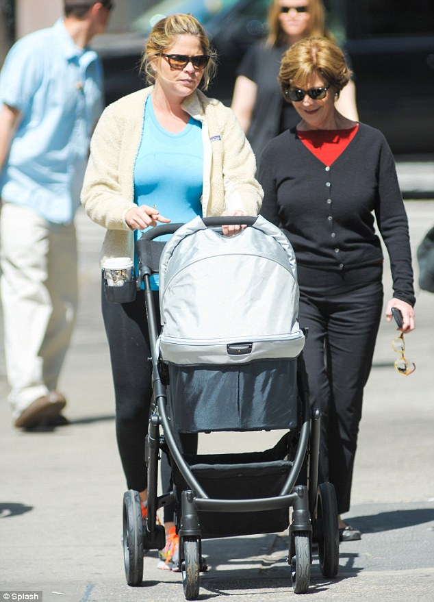 Family stroll: Mrs Bush Hager takes newborn daughter, Margaret Laura 'Mila' Hager out in New York with her mom, Former First Lady Laura Bush