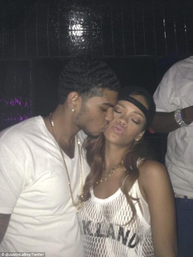 One for the 'wife': Rihanna and Justin took turns to plant delicate kisses on each others cheeks
