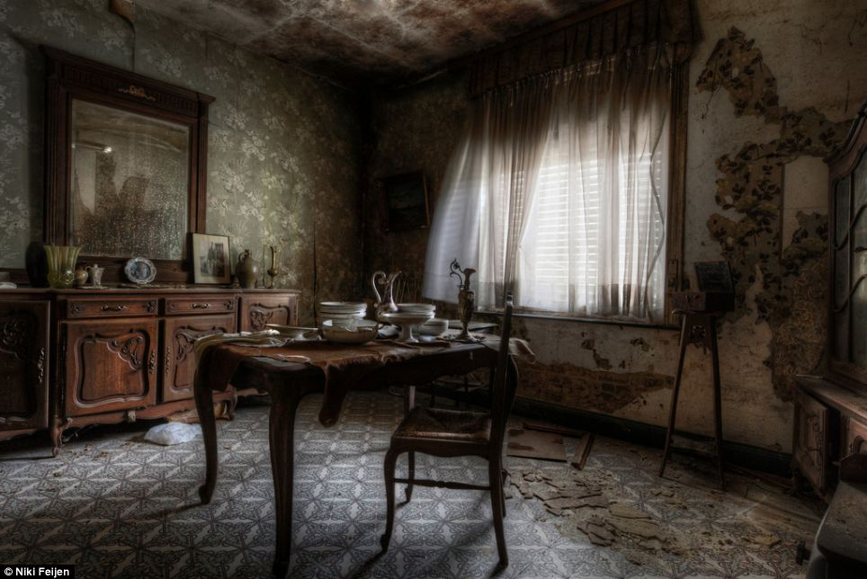 Disused: Ignore the dust, dirt and peeling walls, and this room is almost ready for a family to sit down to a cup of tea