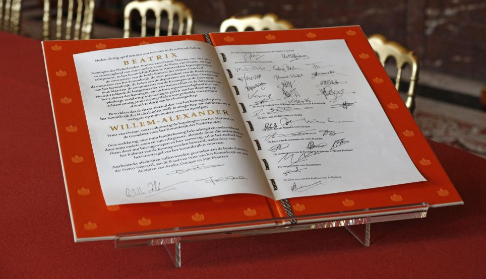 Official: The signed act of abdication of Queen Beatrix of the Netherlands is seen after the official meeting at the Royal Palace this morning