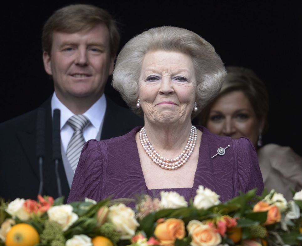 Bittersweet: The new Dutch and his wife followed Princess Beatrix on to the balcony