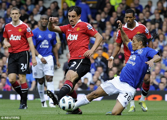 Red Devil Neville: Gary Neville (centre) was part of many trophy-winning sides at Manchester United