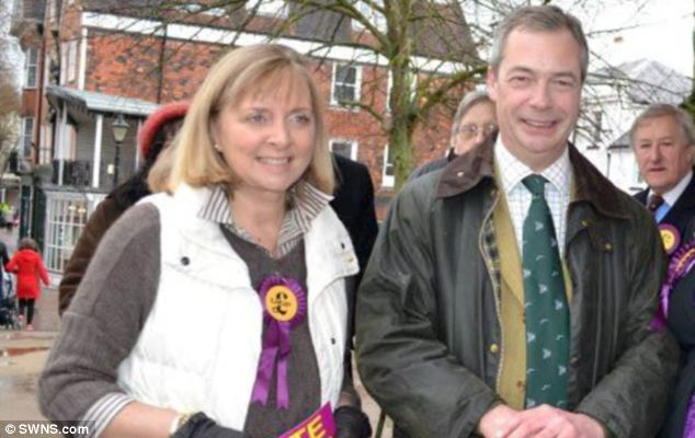UKIP candidate Anna-Marie Crampton (left) posed with party leader Nigel Farage but was suspended for online comments about the Holocaust