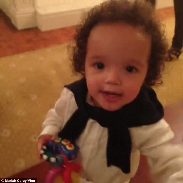 Trendy tot: Little Roc looked positively adorable in a crisp white shirt with a jumper thrown over his shoulders