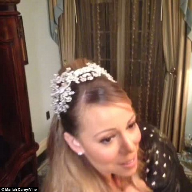 Dazzling: Mariah adorned her head with a glittering diamond tiara, which she teamed with matching earrings and a sparkling necklace