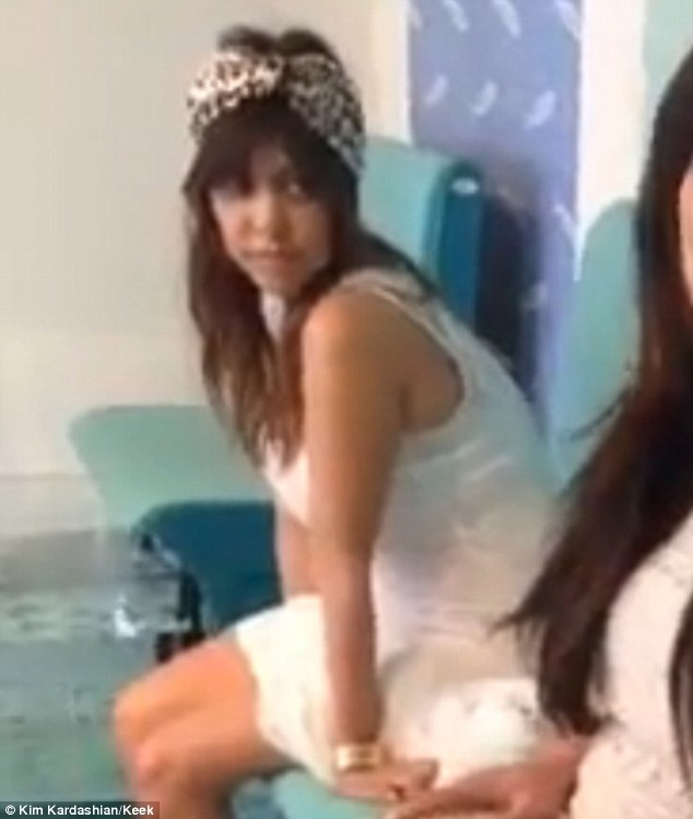 Not bothered: In contrast to her sister Kourtney was calm during her pedicure