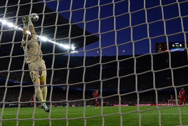 No way past: Bayern Munich goalkeeper Manuel Neuer (left) saves a shot from distance