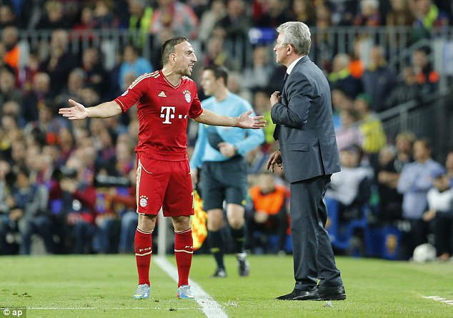 Heated: Bayern head coach Jupp Heynckes (right) talks to midfielder Franck Ribery