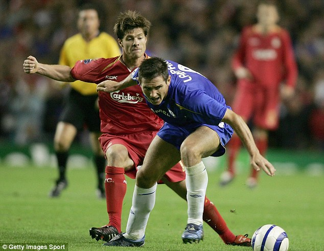 Hold up: Frank Lampard could complicate a move for former Liverpool favourite Alonso to join Chelsea, should he agree a new one-year contract extension