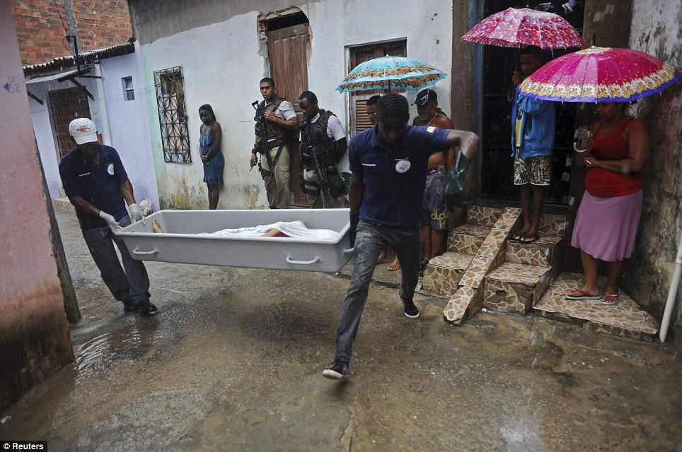 Police forensic workers remove Rodrigo's body from the densely populated back streets as residents look on