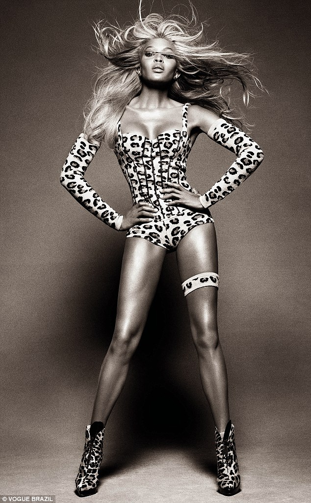 She's an animal: The supermodel looks fierce in a leopard-print leotard and matching boots. She even updated her tresses with a blonde 'do