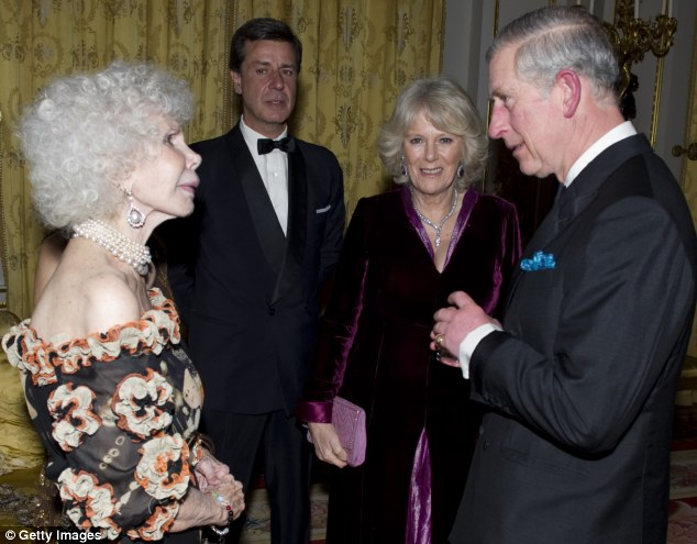 Royal visit: The Duchess of Alba speaks to Prince Charles and Camilla at a charity gala dinner in London, in 2011