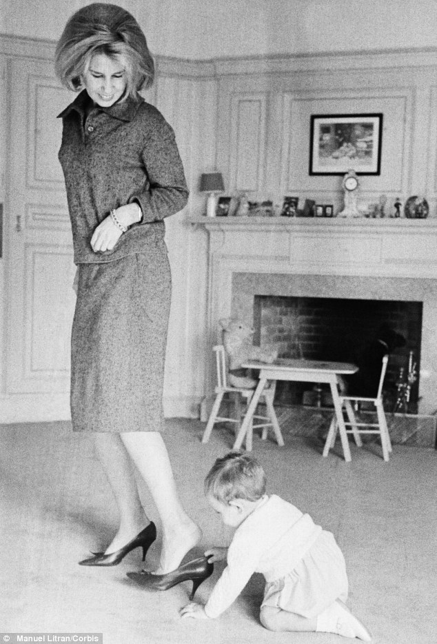 Loving mother: The Duchess of Alba is caught on camera with and her baby son Fernando in January 1961