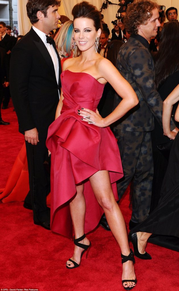 Just a hint of punk: Kate Beckinsale gave her strapless red gown a punk twist with a quiff hairstyle and lots of black eyeliner