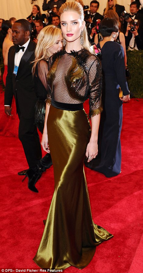 Pretty and punky: Rose Huntington-Whiteley managed to stick to the theme while still looking very feminine in her glamorous Gucci creation
