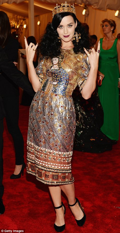 Queen Katy: Miss Perry looked amazing in a crown, religious inspired dress by Dolce & Gabbana and vampish lipstick
