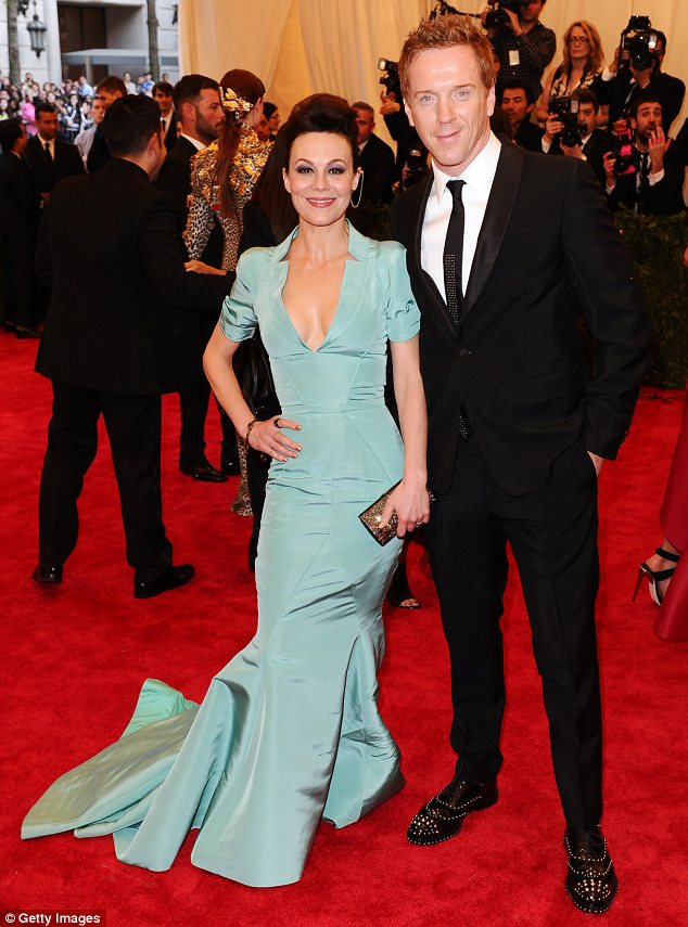 Dashing with a twist: Damian Lewis arrived with his wife Helen McCrory on his arm. The actor sported a pair of studded shoes while Helen had a chain earring in
