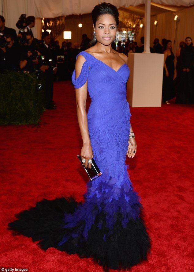 Pretty in purple: Naomie Harris wore a Donna Karen gown