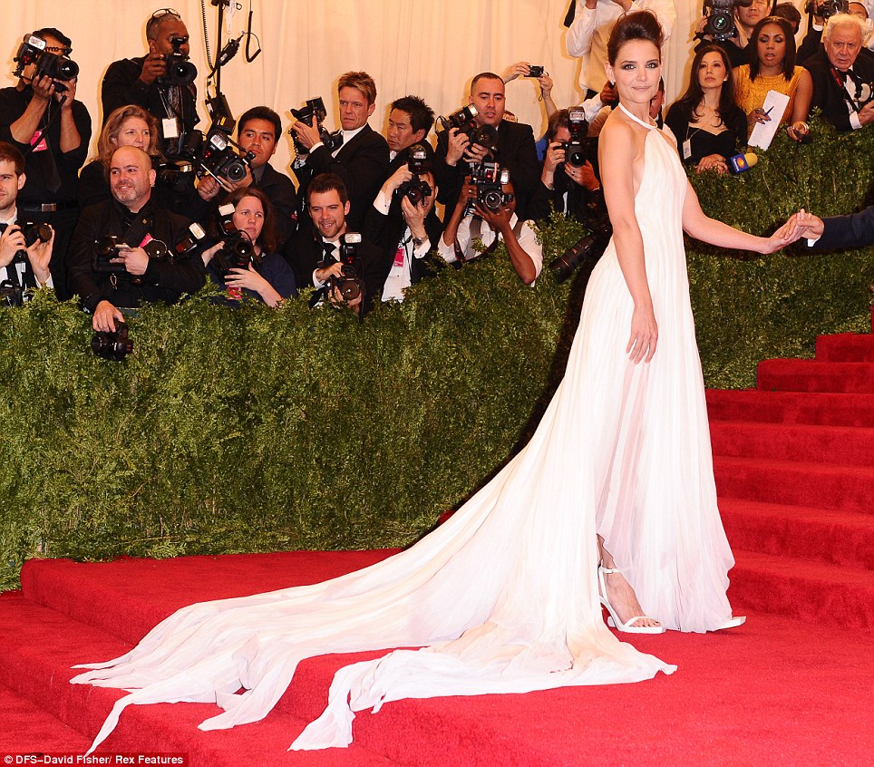 Gladrags: Katie Holmes chose a flowing white Calvin Klein dress which had a split train reminiscent of the awkward moment you get toilet roll stuck to your shoe