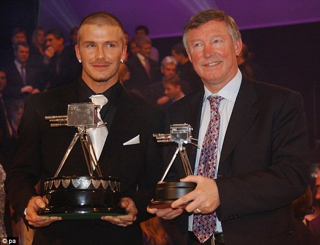Double top: Fergie, holding a Lifetime Achievement Award, with David Beckham, the winner of the BBC Sports Personality of the Year Award in 2001