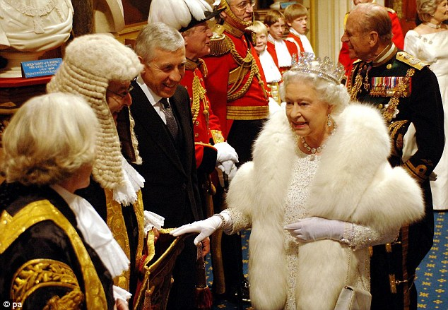 Queen Elizabeth II talks to Lord Chancellor Lord Falconer and Leader of the House of Commons Jack Straw at the Norman Porch following the State Opening of Parliament in 2006