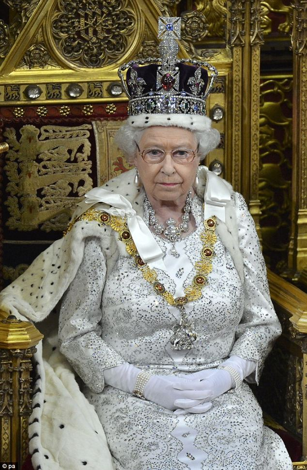 The Queen attended the State Opening of Parliament wearing the Robe of the State, the Imperial Crown, a white dress and gloves, and Queen Victoria's pearl earrings and Jubilee necklace