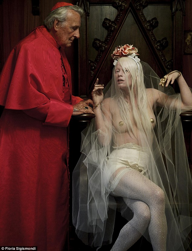 Scantily-clad: A cardinal is seen handing out cash to an androgynous-looking bride