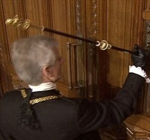 Tradition: Black Rod hammers the door of the House of Commons to invite MPs to proceed to the House of Lords to listen to the Queen's Speech