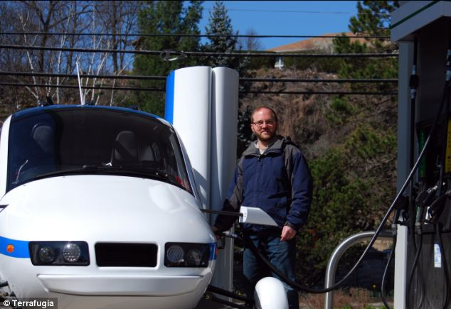 Refuelling: A Terrafugia test pilot fills up the Transition flying car with petrol. The Transition can hold 23 gallons of usable fuel and uses 5gph during flight