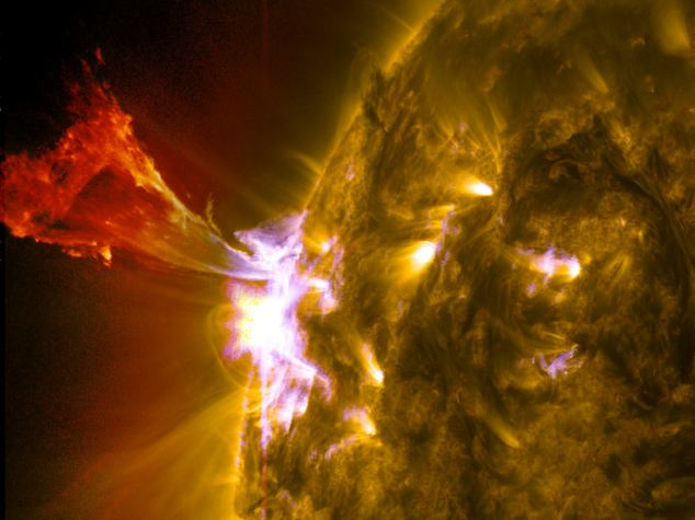 A burst of solar material leaps off the left side of the sun in what is known as a prominence eruption.