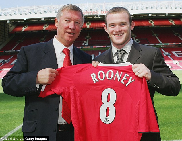 Mentor: Rooney with Sir Alex Ferguson on the day he signed for United in 2004