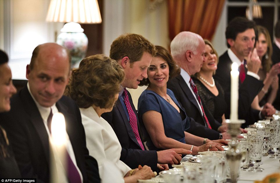 The lady's watchful eye: Lady Westmacott, the wife of the British Ambassador, was seated to Harry's left and the two shared a nice moment during dinner
